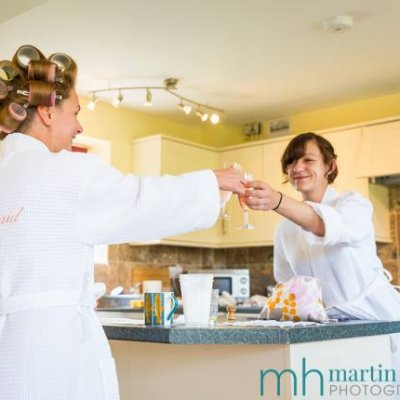 Bridesmaids toast the bride at East of Eydon cottage.