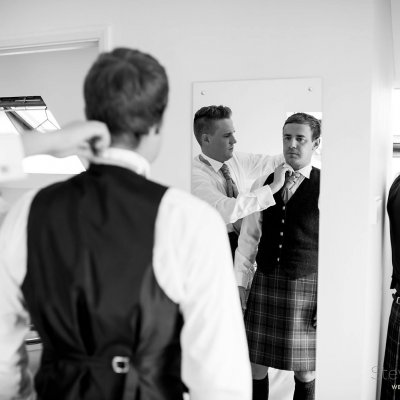 Last minute adjustments for the groomsmen.