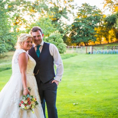 Emma & Paul make use of the stunning gardens at Crockwell Farm for their wedding pictures.