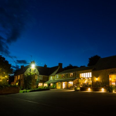 Crockwell Farm in Northamptonshire lit up beautifully at night.