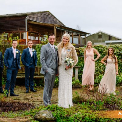 The wedding party pose for shots in the walled garden.