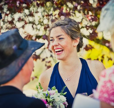 A bridesmaid full of laughter.