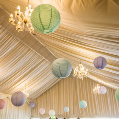 Pom poms hang from the ceiling for extra decoration.