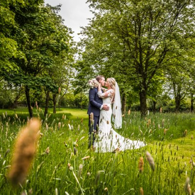 Dyanne & Matthew in the immaculate gardens at Crockwell.
