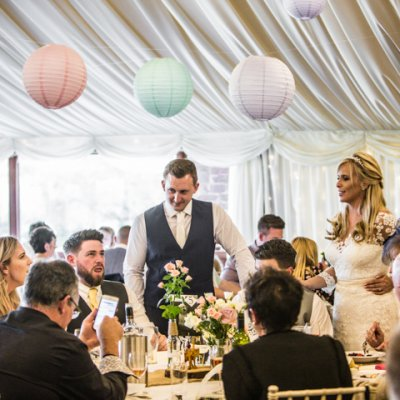 Dyanne & Matt visit each table individually to speak to their guests.