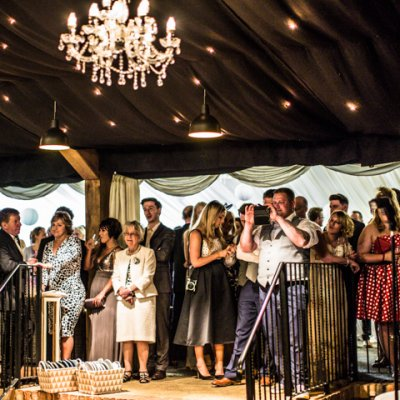 Guests look on and clap as they watch the first dance.