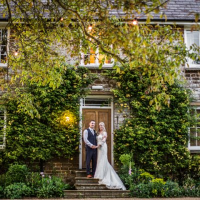 Dyanne & Matt using the beautiful old house as a backdrop.