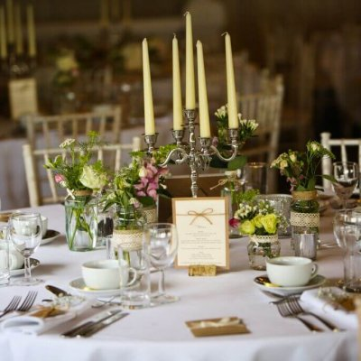 Candleabras create a majestic centre piece on a laid table.