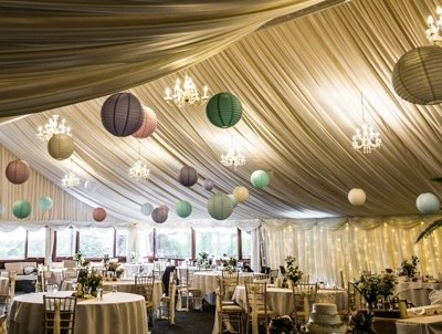The main marquee with pom poms hanging from the ceiling.