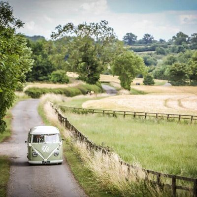 Natalie & Neil make their way from the Church in their VW camper.