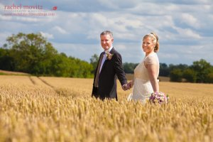 A bride & groom in the wheat.