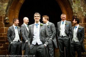 The groomsmen gather outside the church.