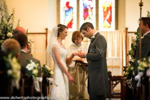 Exchanging rings at the altar.