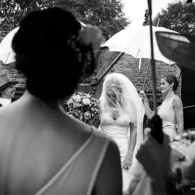 Don't let the rain spoil your day, Sophie's bridesmaids do a great job of keeping her dry and looking beautiful on the way to Eydon church.