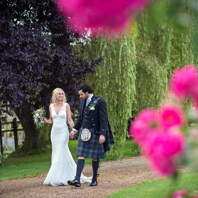 Sophie & Shaun strolling through the gardens on their magical day.