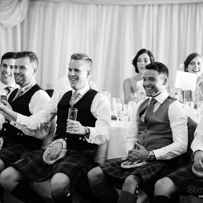 Boys in their kilts lauging at the speeches.