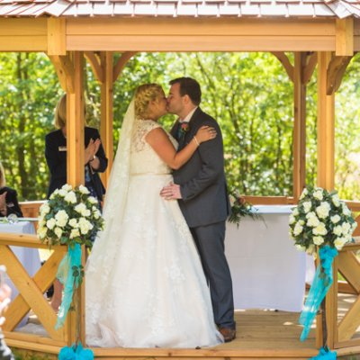 A couple tying the knot in the orchard pavilion at Crockwell Farm.