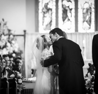 The bride meets her groom at the altar.