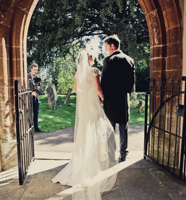 Leaving Eydon church for the first time as Mr and Mrs Cox.