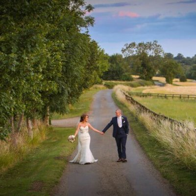 Natalie & Neil stroll down the drive at Crockwell Farm wedding venue, Northamptonshire.