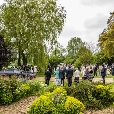 Guests greet the newly weds in the gardens at Crockwell.