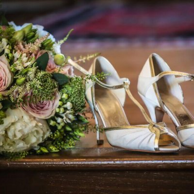 A brides boquet and her shoes.