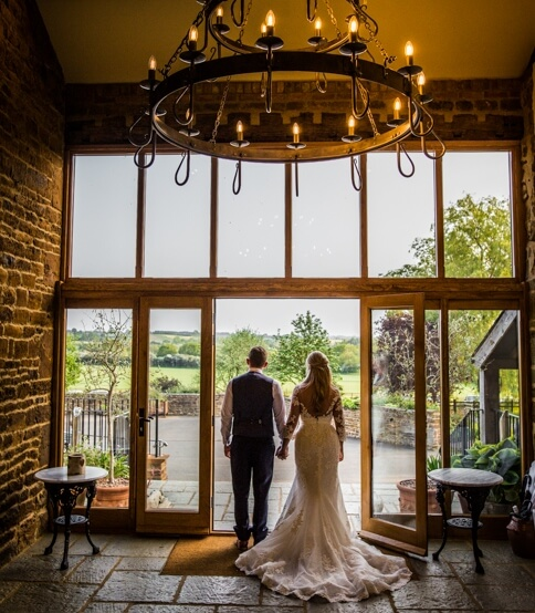 Dyanne & Matt under the chandelier at our wedding venues northamptonshire