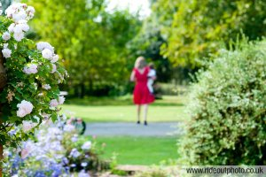 A guest enjoys a walk in the gardens and is captured by the photographer.