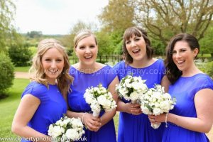 Bridesmaids in vibrant blue.