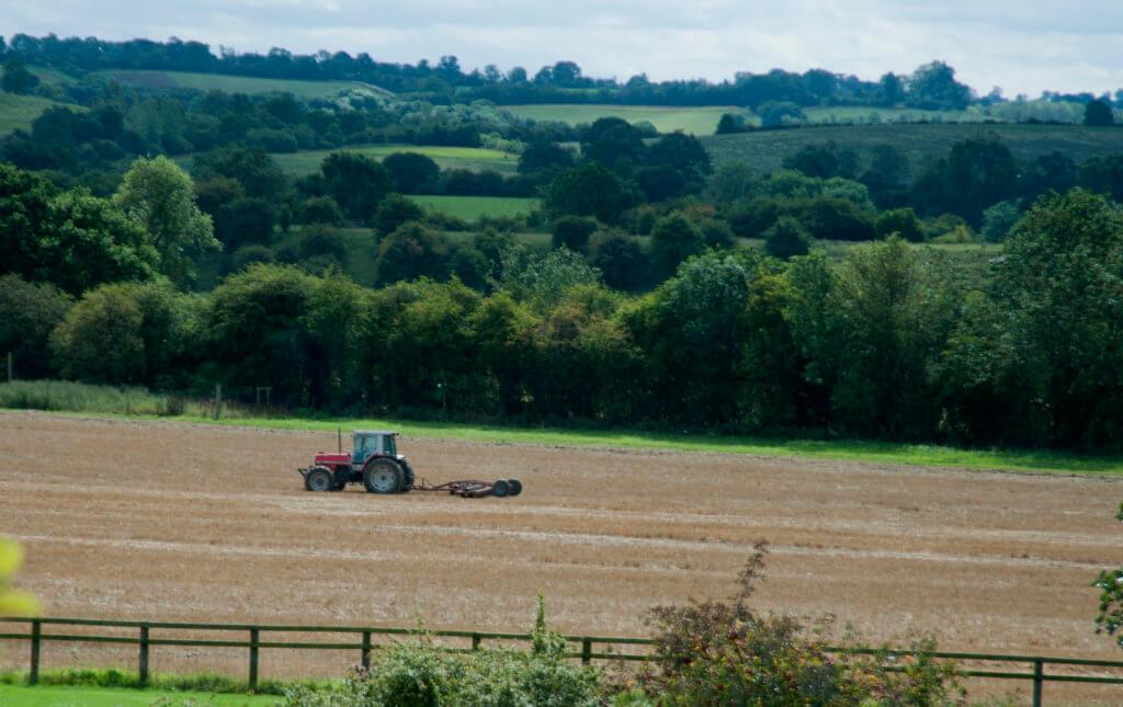 farmer in tractor in field