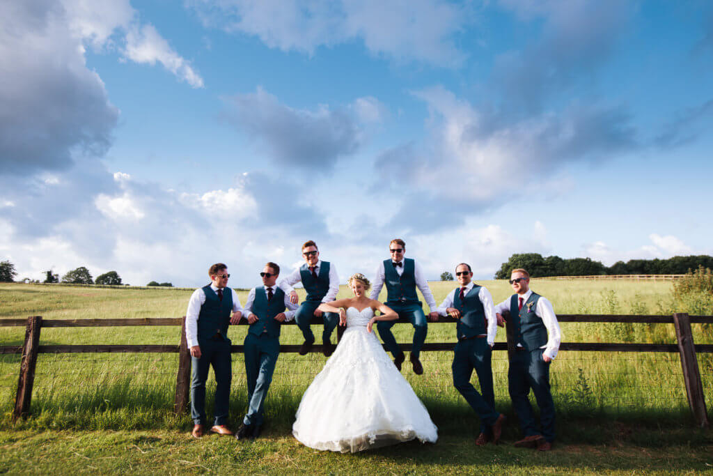 bride and groomsmen having photos taken