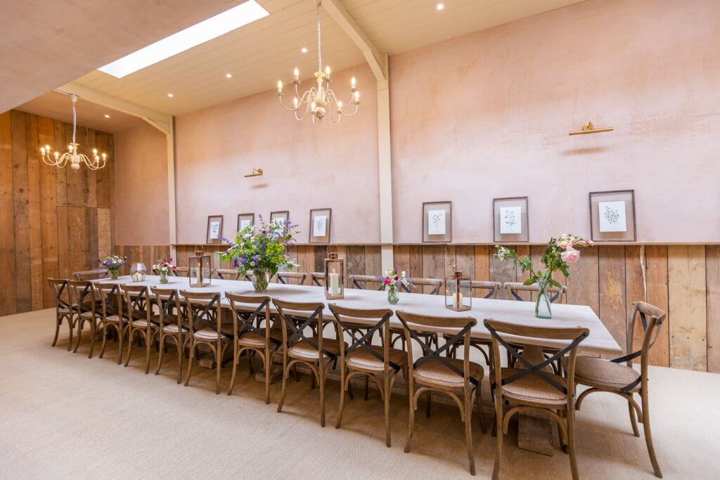 Large banqueting room for wedding morning breakfast for overnight guests.